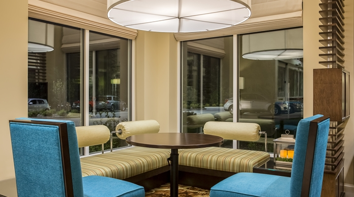Corner seating area with booth, chairs and table at the Hilton Garden Inn in Bettendorf, IA