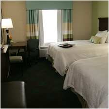 Bedroom in the Hampton Inn & Suites in Shakopee, MN