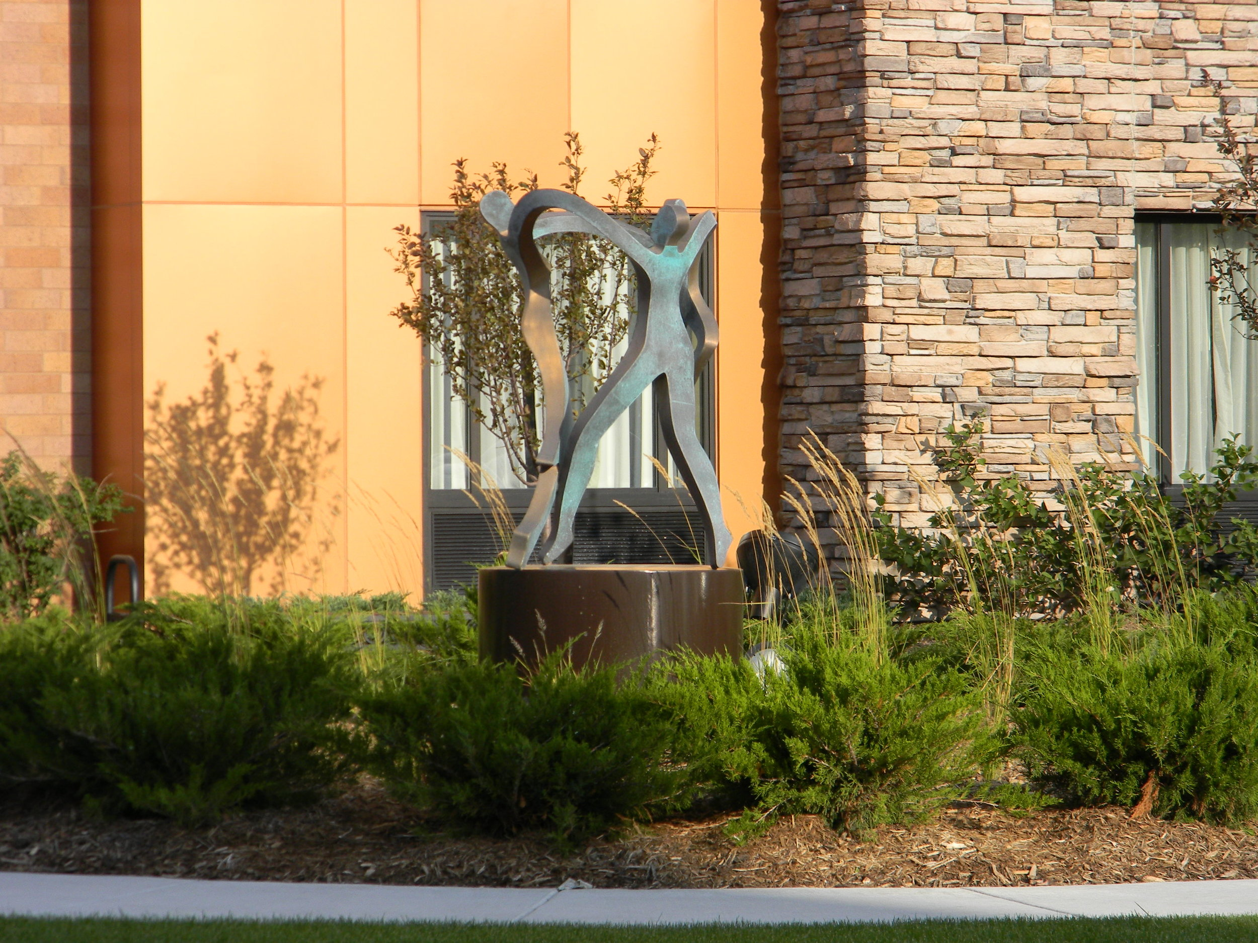 Statue outside of the Homewood Suites in St. Louis Park, MN at night