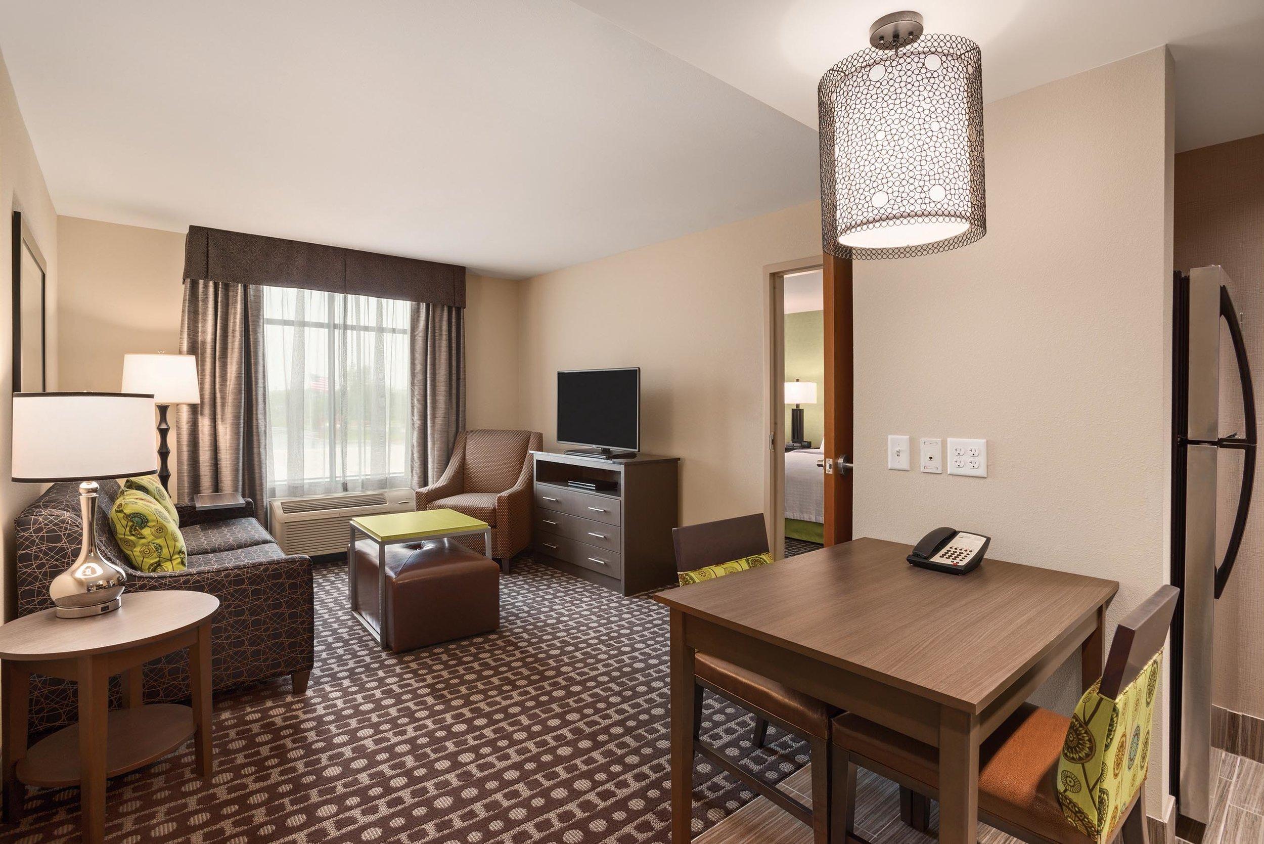 Bedroom living room area in the Homewood Suites in Ankeny, IA