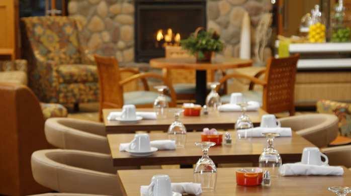 Breakfast seating area in the Hilton Garden Inn in Cedar Falls , IA