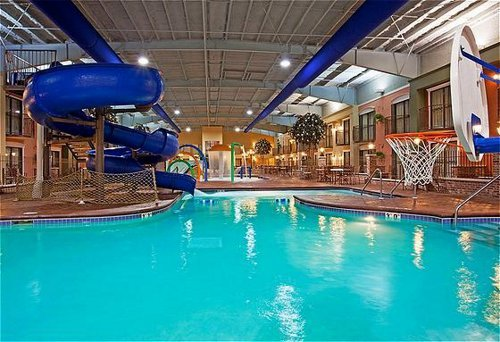 Pool area with a slide in the Holiday Inn in Lakeville, MN