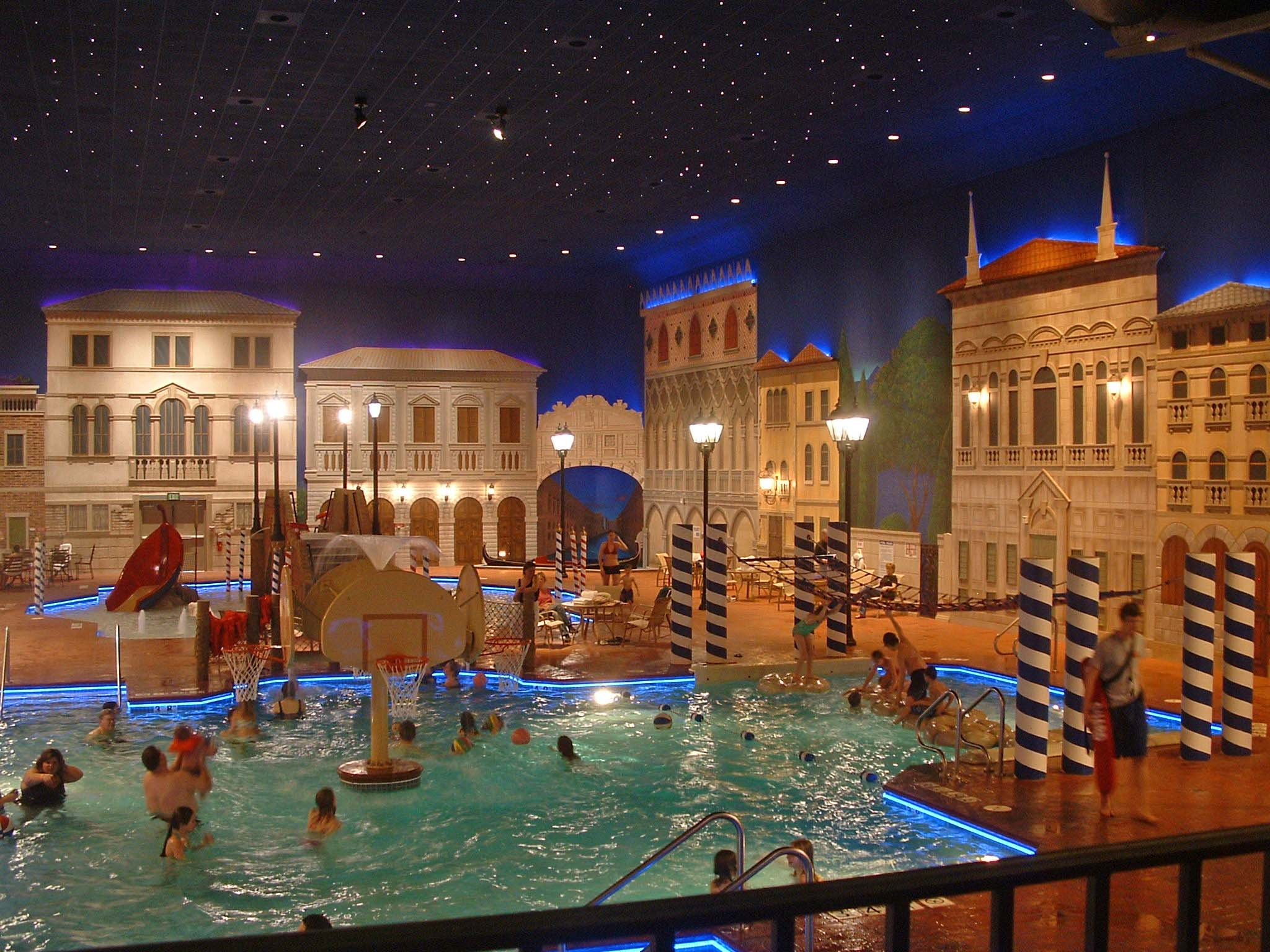 Inside pool area with a night time city theme at the Holiday Inn in Maple Grove, MN