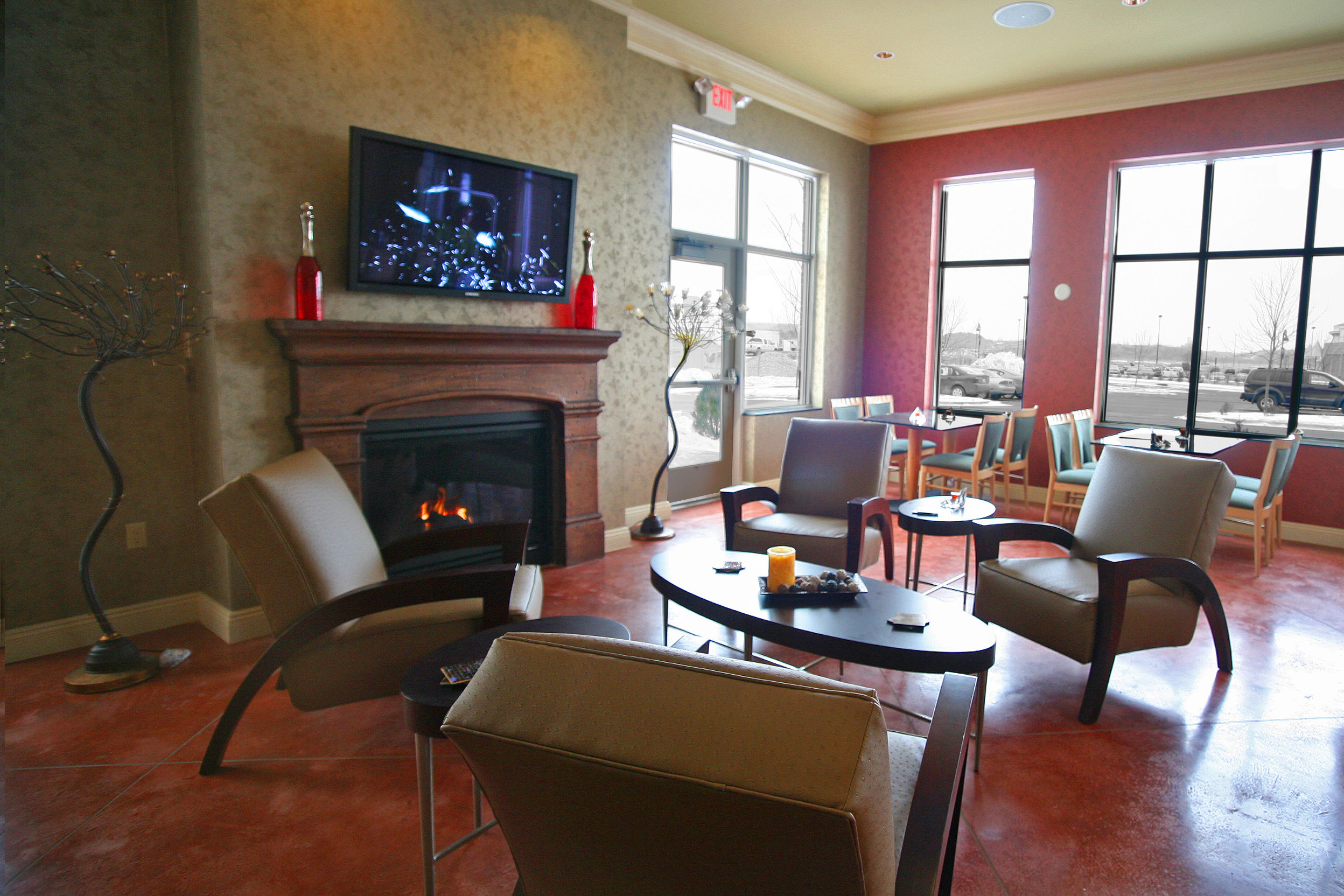Seating area by a fireplace in the Holiday Inn in Maple Grove, MN
