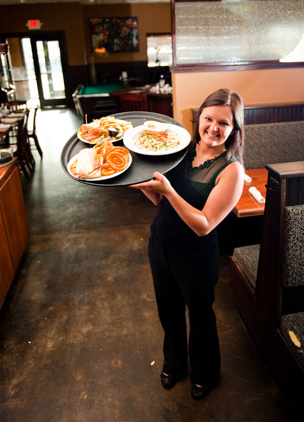 Waitress holding a tray of food at Max's Grill in Olivia, MN