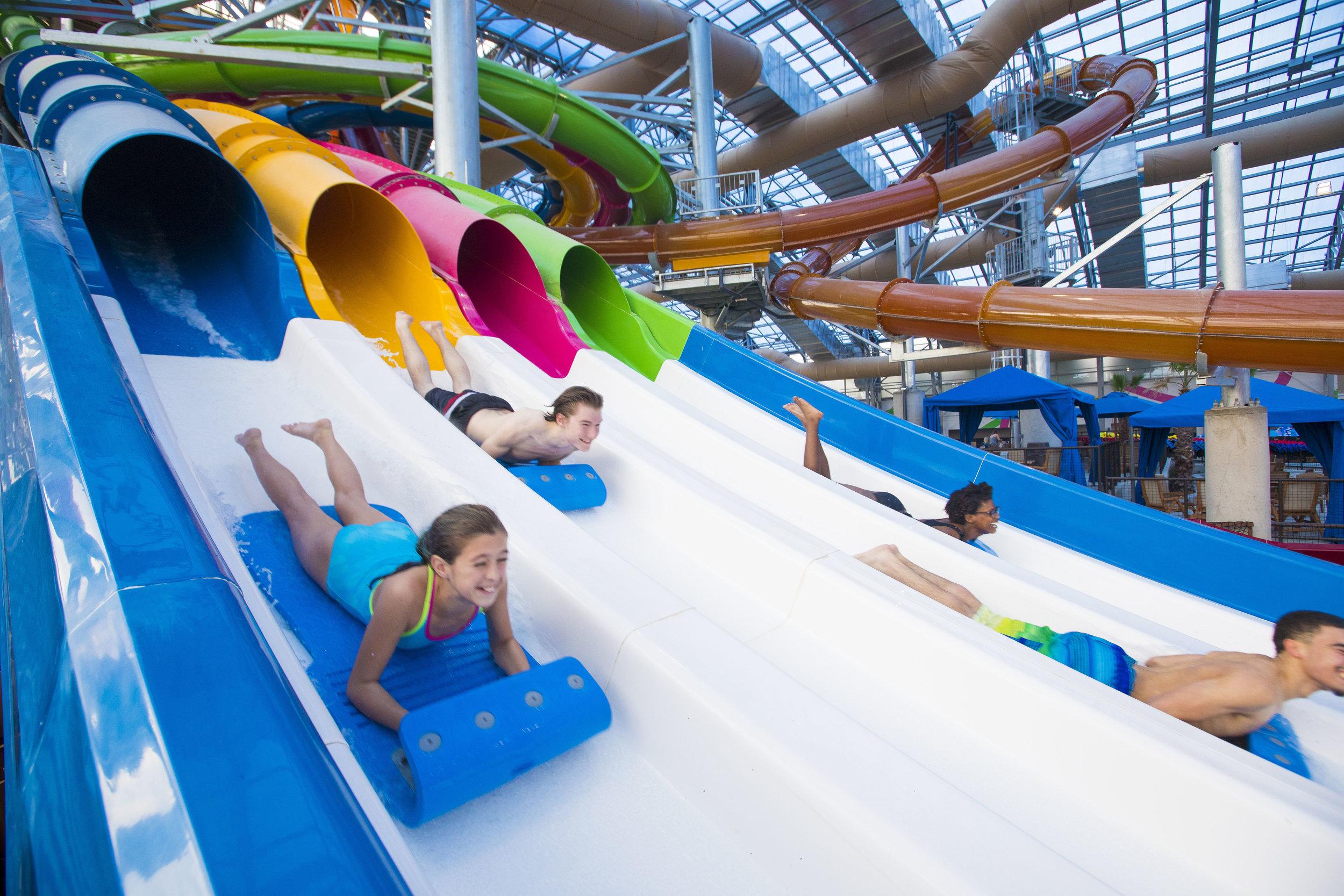 Kids racing down the mat racing slides