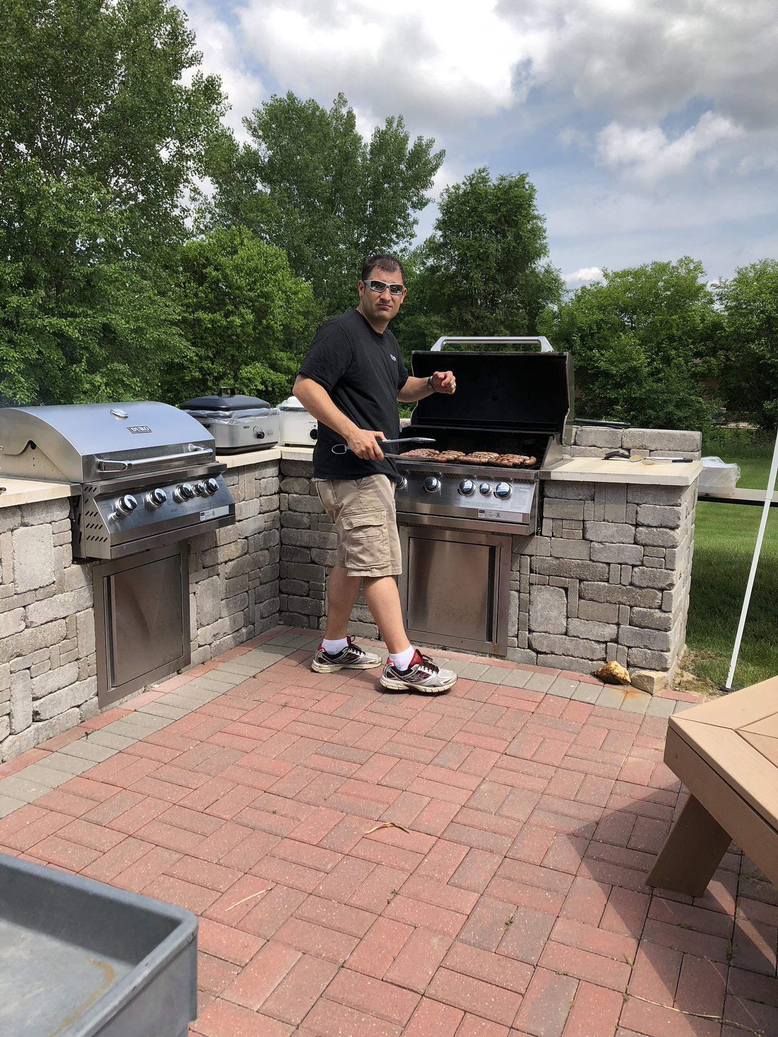 Sauk City employee grilling on the back patio