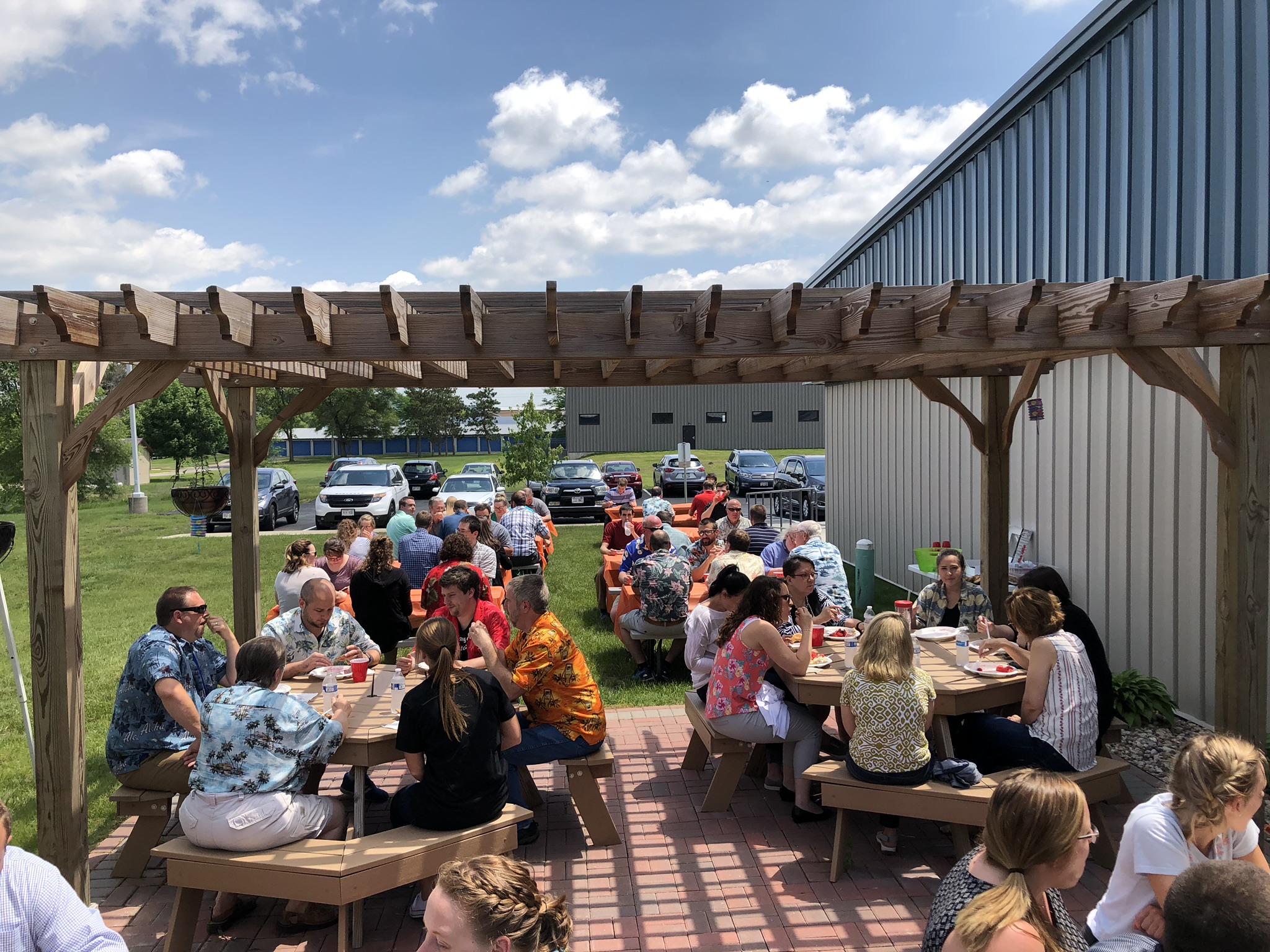 Sauk City employees enjoying the company picnic outside on the patio