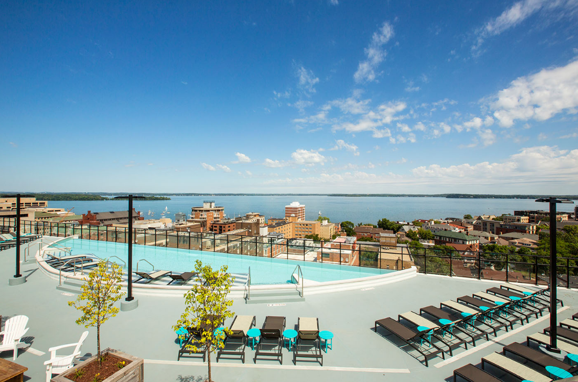 Rooftop view of the outdoor pool and pool area during the day at The HUB in Madison, WI