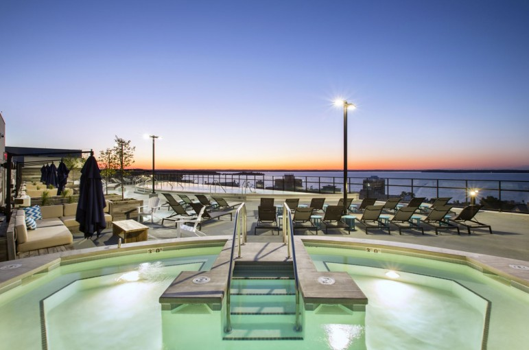 Nighttime view of the outdoor rooftop pool area at The HUB in Madison, WI