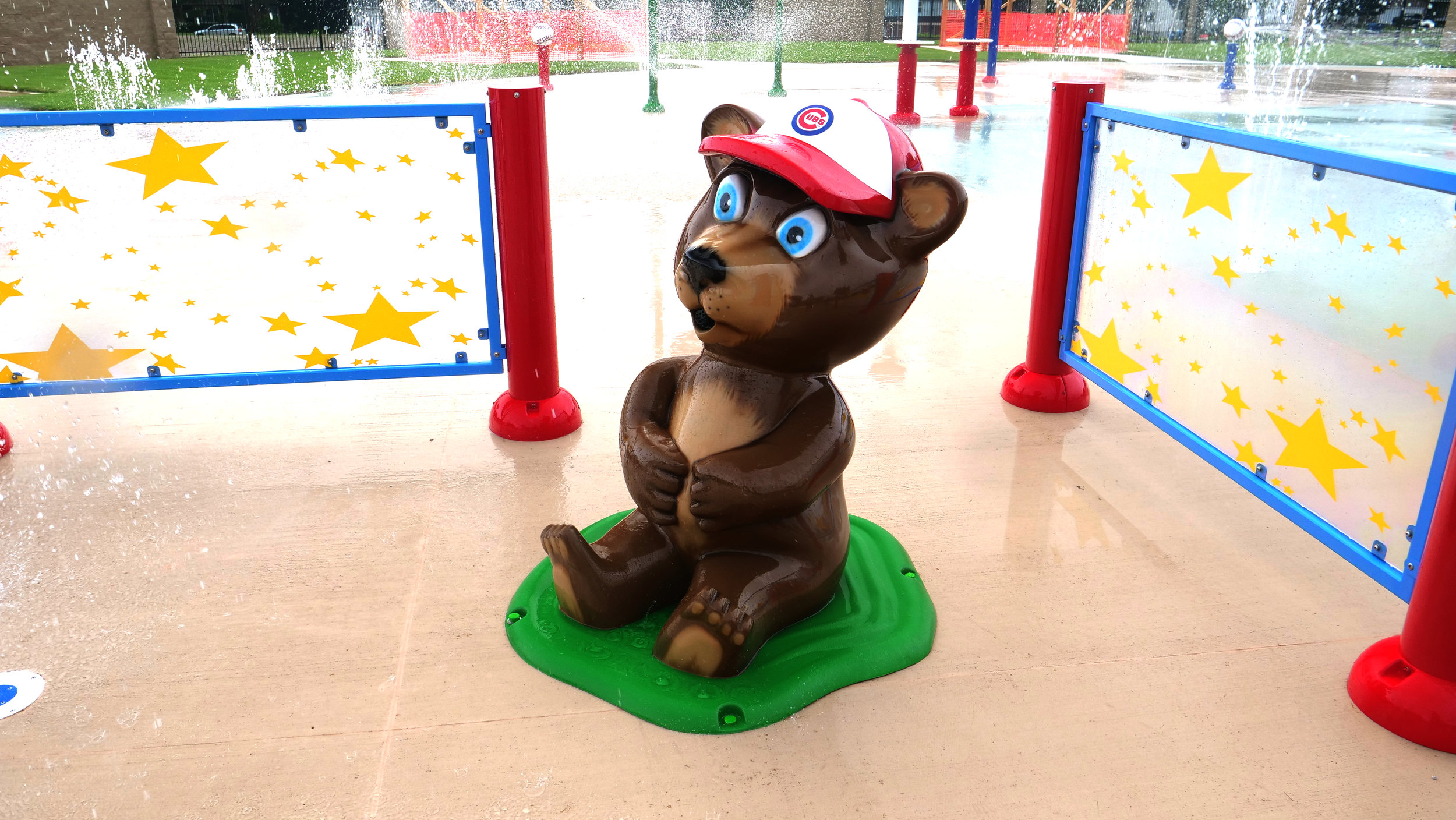 Large sitting bear with a Chicago's Cub hat in the kids play area at Peru's Splash Field in IL