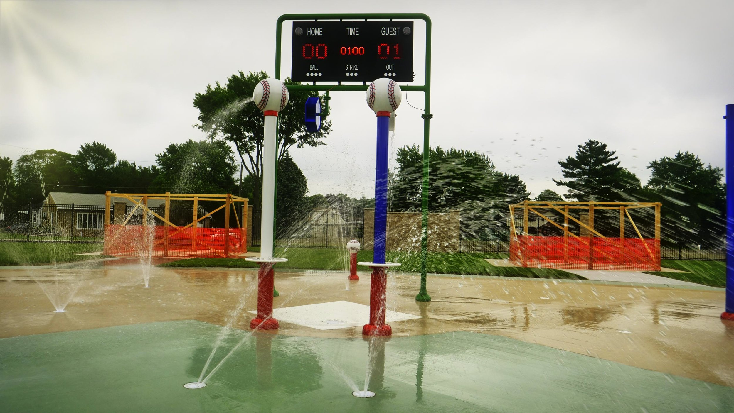 Score board  with baseball bases in the kids play area with a baseball theme at Peru's Splash Field in IL