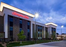 Nighttime view of the outside of the Hampton Inn Hometown in Spicer, MN