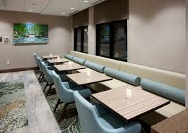 Breakfast seating area with table in the Hampton Inn Hometown in Spicer, MN