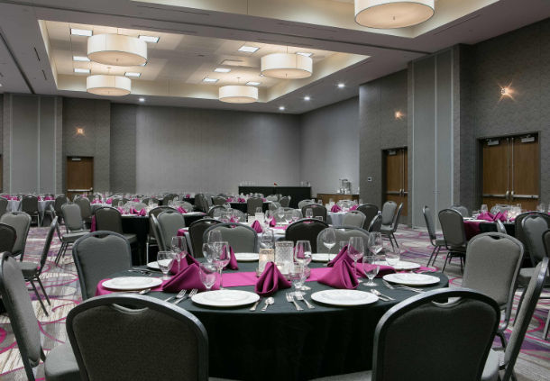Banquet room with chairs and table in the Courtyard Hotel in Bellevule NB