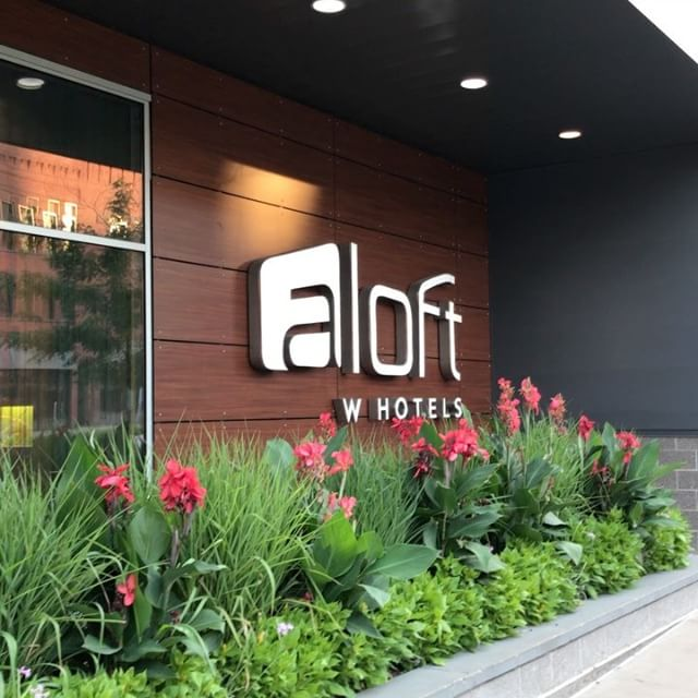 Sign of the hotel's name on wall outside of the Aloft Hotel in Minneapolis, MN