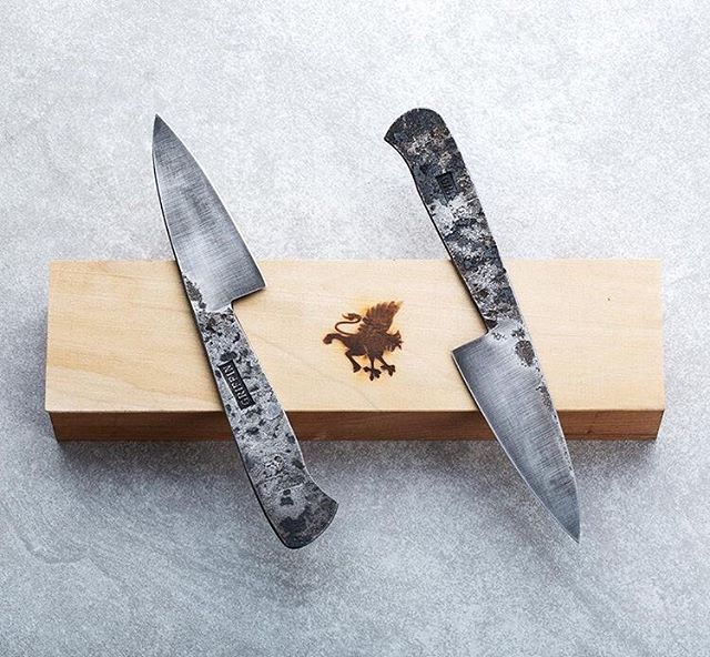 Blacksmith's paring knives for sale on @eatingtools. Photo from their website. I've been working on this design a long time. It's meant to be an affordable paring knife with an emphasis on thin geometry and high hardness heat treatment of 52100. They are also taller than average paring knives which allows you to cut things like garlic and scallions on a cutting board. Lots of fun to make and use.
