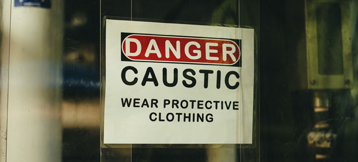 Caustic Safety Warning: Danger Caustic. Wear Protective Clothing