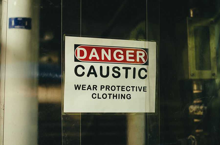Danger Caustic Wear Protective Clothing