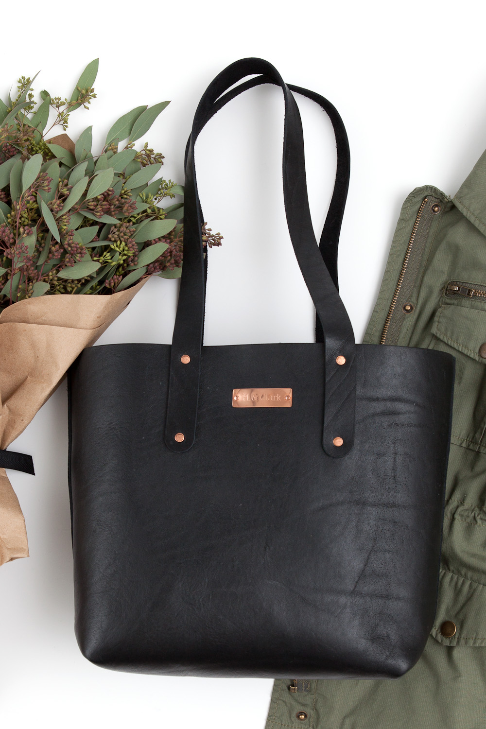 styled product black leather tote
