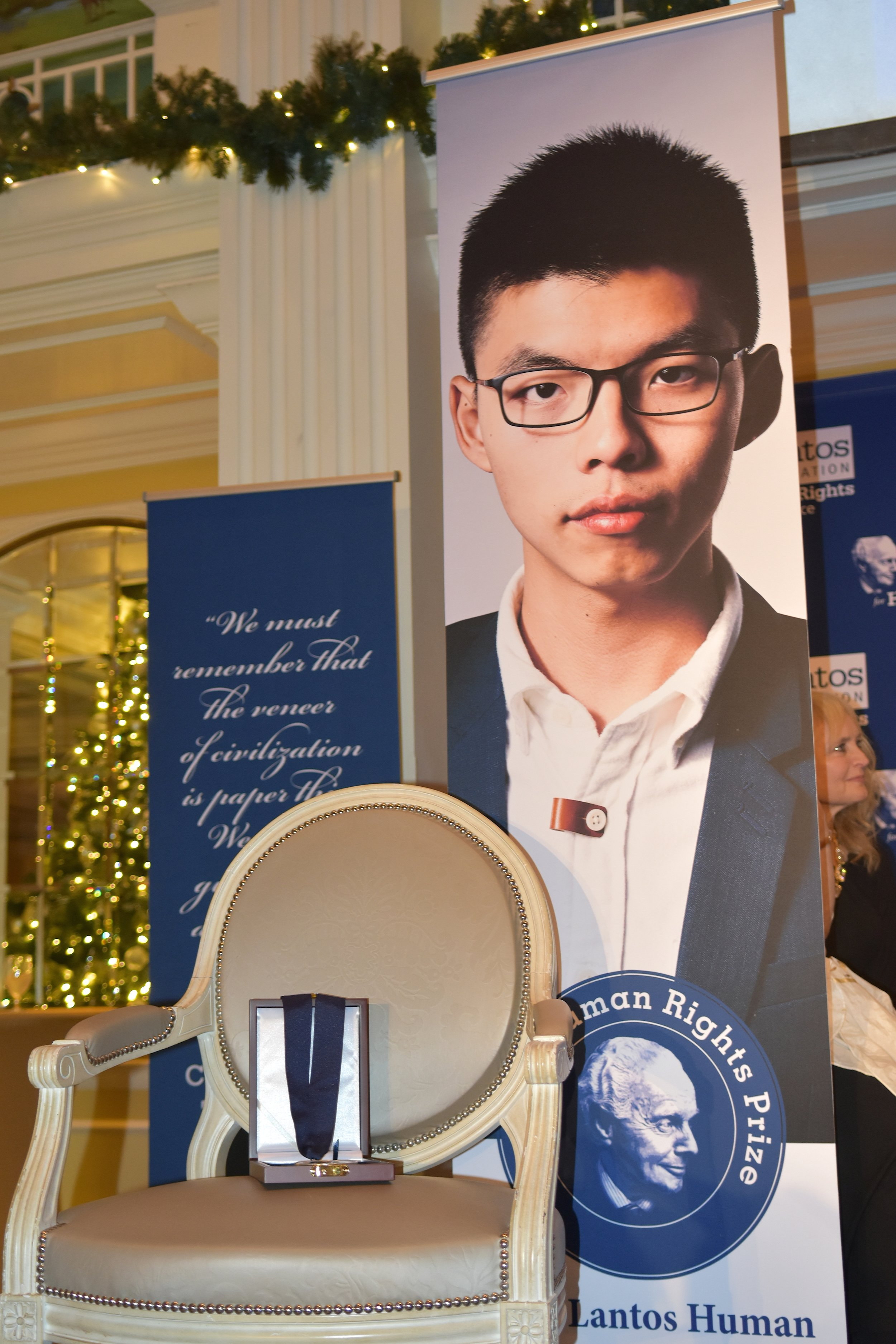 Joshua Wong's chair sits empty at the 2018 Lantos Human Rights Prize Ceremony.