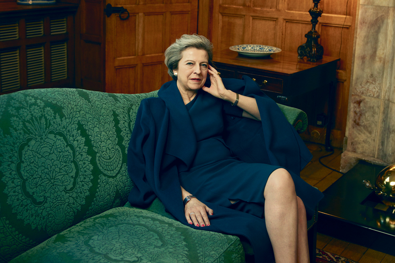 Theresa May, the first British prime minister to be featured in US Vogue, wearing a coat and dress by LK Bennett for an article in the April issue of American Vogue. Photo credits | Portrait photographer @Annie Leibovitz.