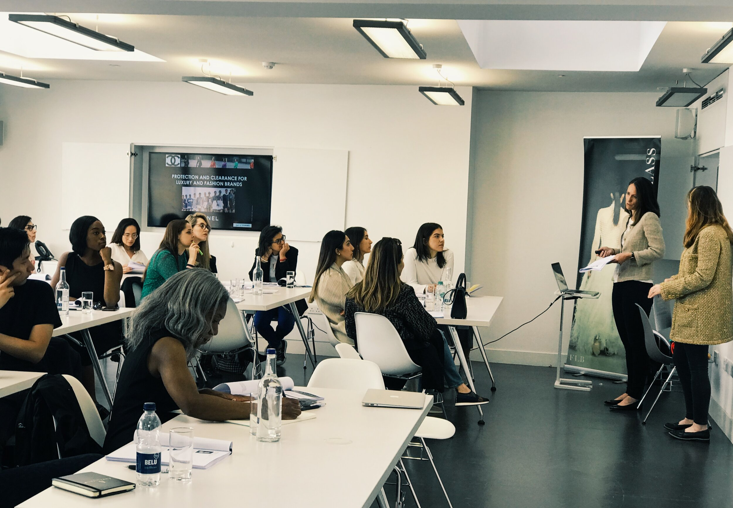 Lucy Aboulian, Head of Intellectual Property (Regional) and Philippa Bailey, Intellectual Property Legal Counsel of    CHANEL    speaking to attendees at FLB's summer Fashion Law Masterclass, 2019