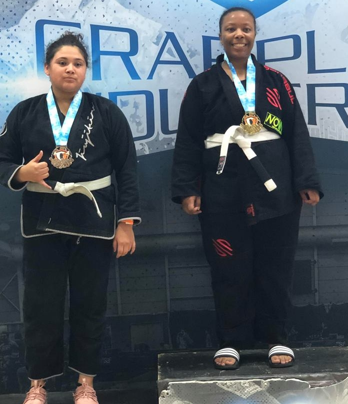 Andrea from Oak Creek Nova Gym wins Gold at BJJ competition after only 3 months of training Jiu Jitsu.