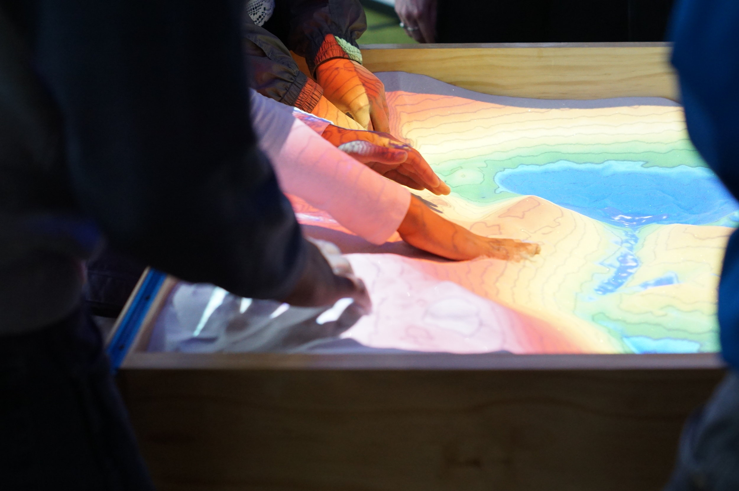 A place for all hands... The AR table invites cooperative interaction by its very nature.