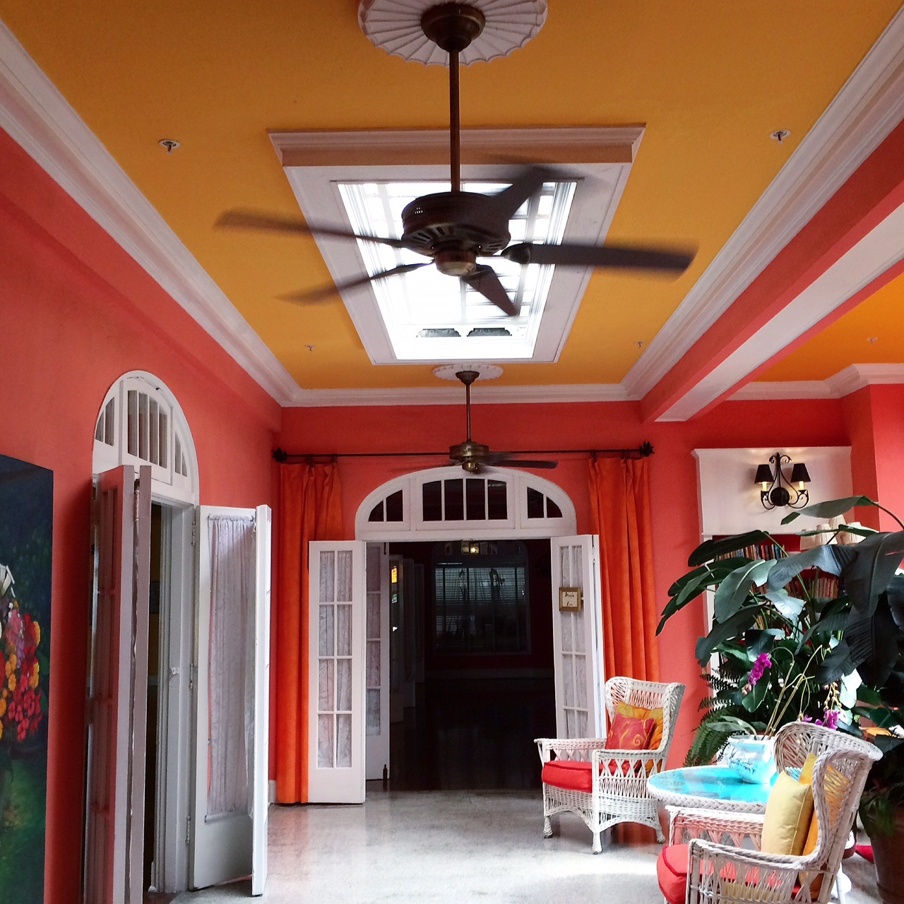 The bright lobby of the Colony Hotel