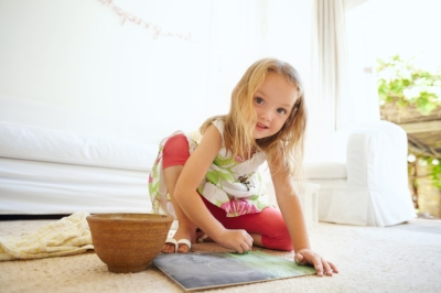 Happy young girl drawing a picture, flexible easy child