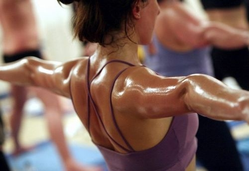 Woman doing yoga workout and sweating