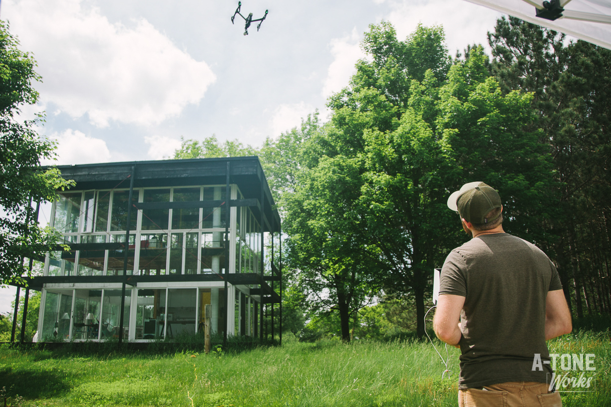 Corey flying a drone at the cube, Day 1 of Rapson Cube project