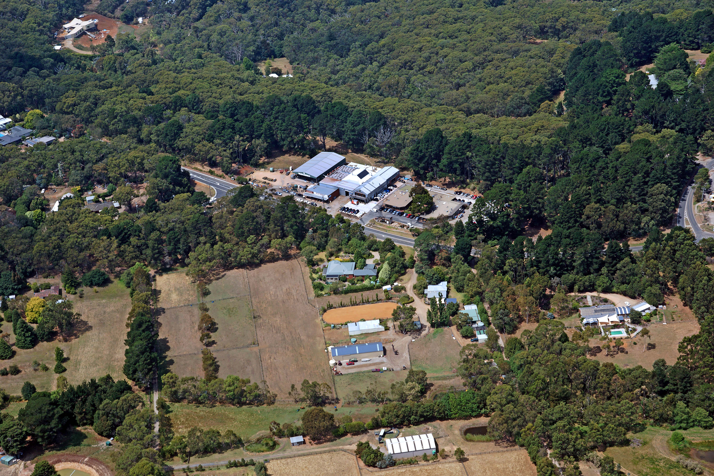 Aerial view of The Epicurean Red Hill building, nestled in amongst the lush national forests of Red Hill