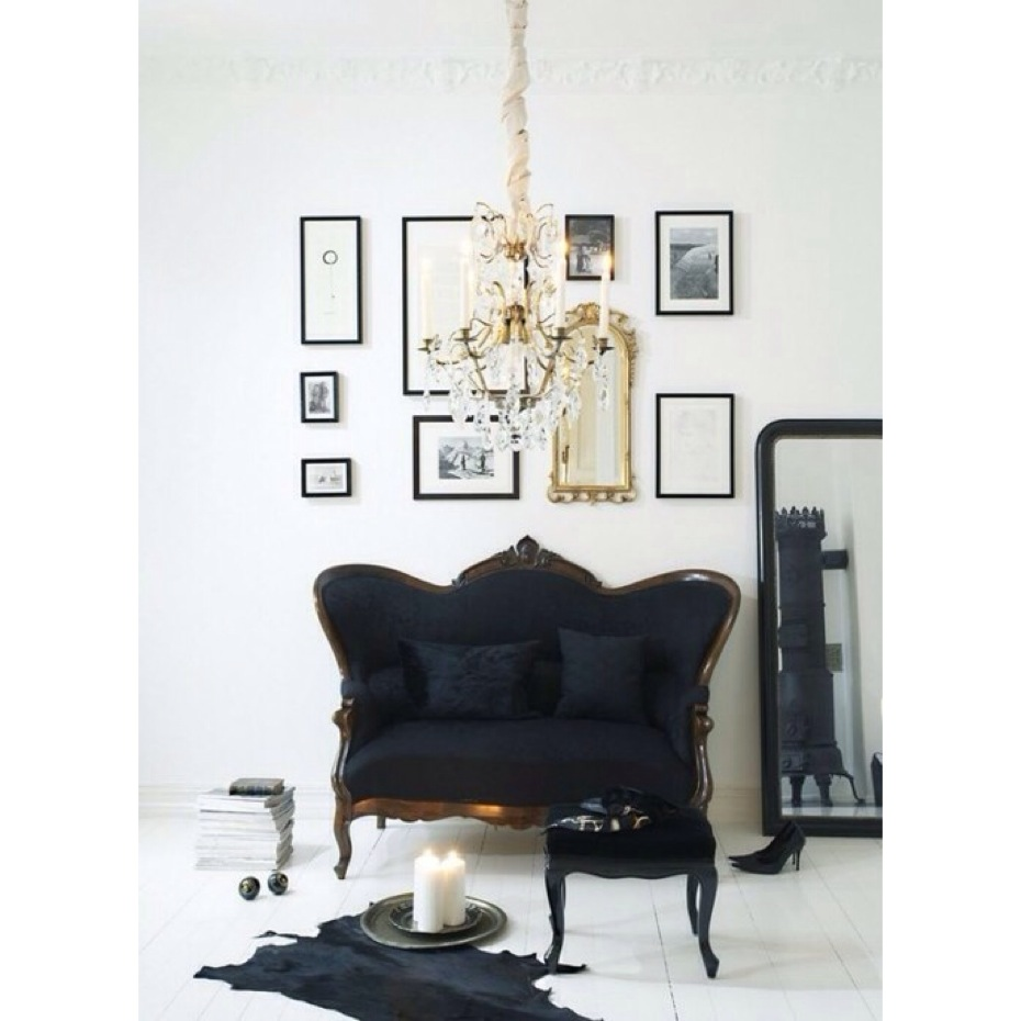 Elegant gallery wall with a mirror