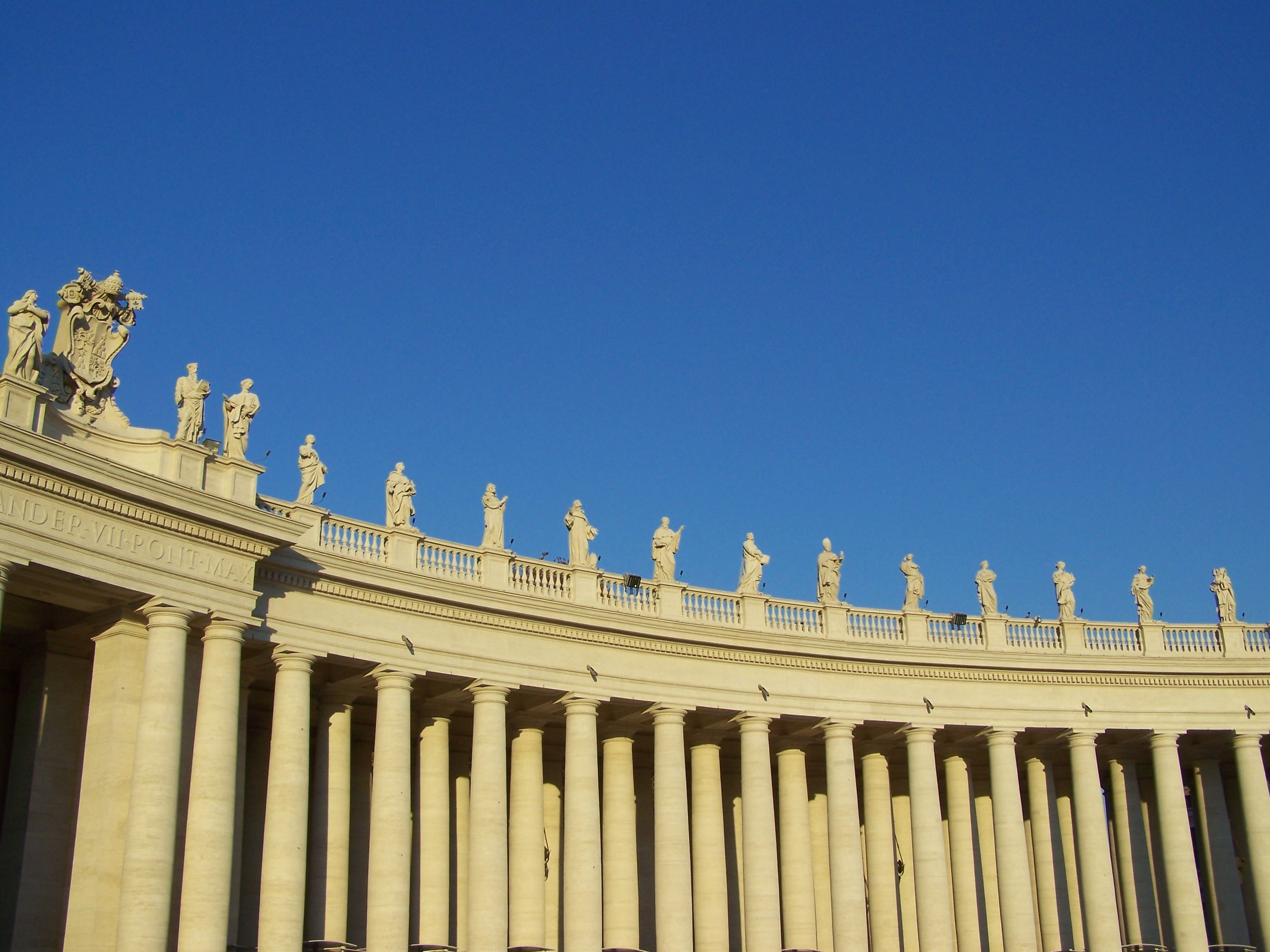 Saints watch as we wait to enter St Peter's Basilica.JPG