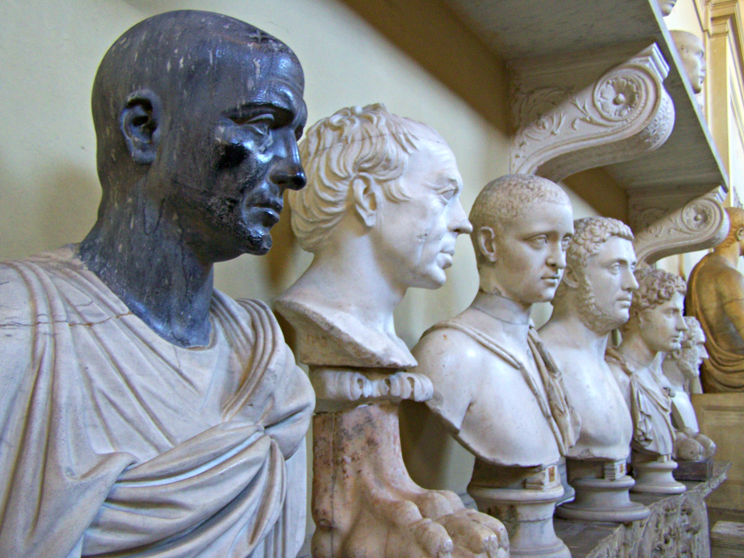 Various caesars and torsos in the Vatican Museums.jpg