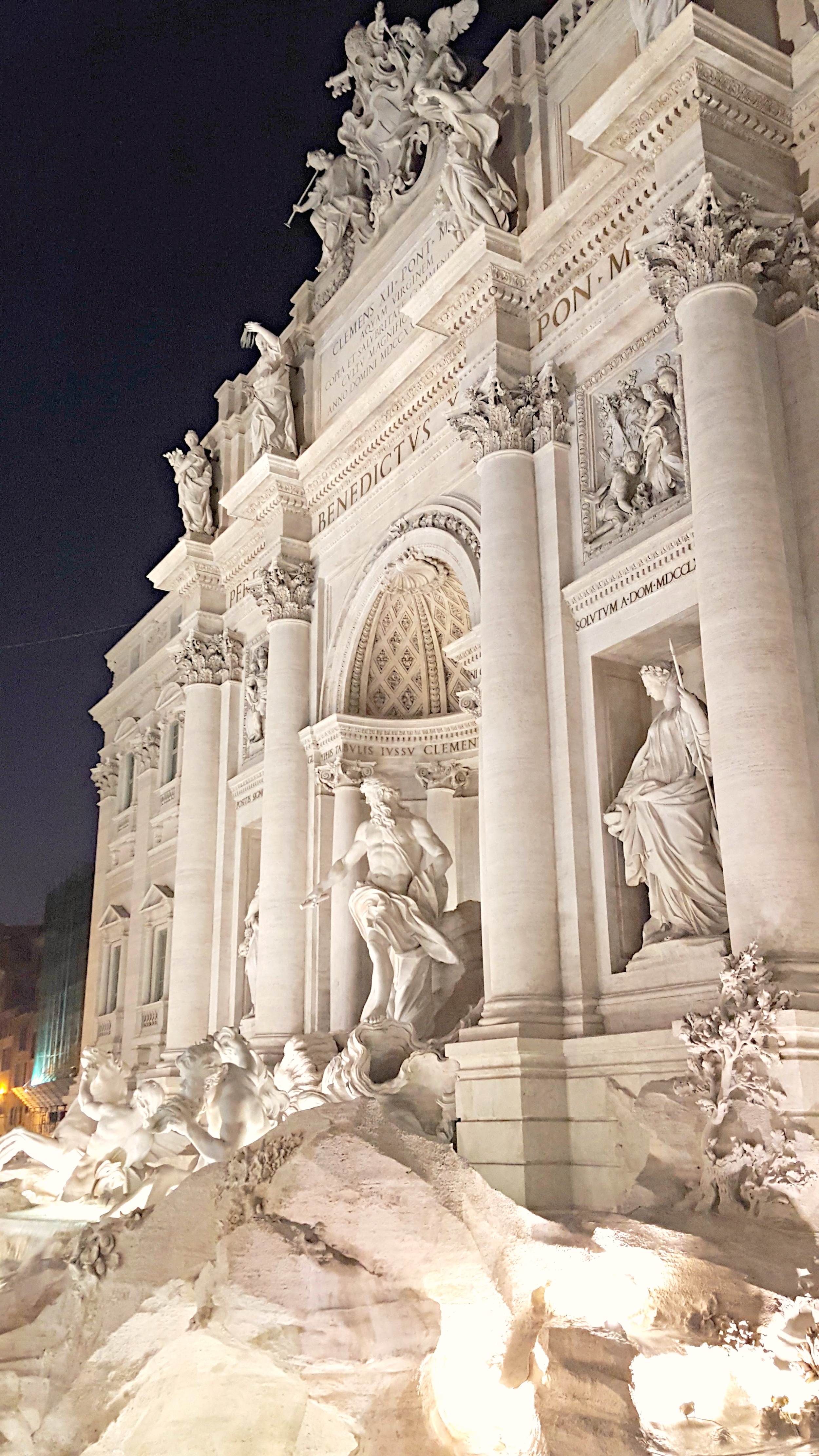 The freshly cleaned white marble Trevi Fountain enchanting hundreds