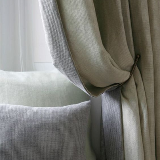 These linen curtains aren't sheers,  but creating a contrasting lining is a special touch.