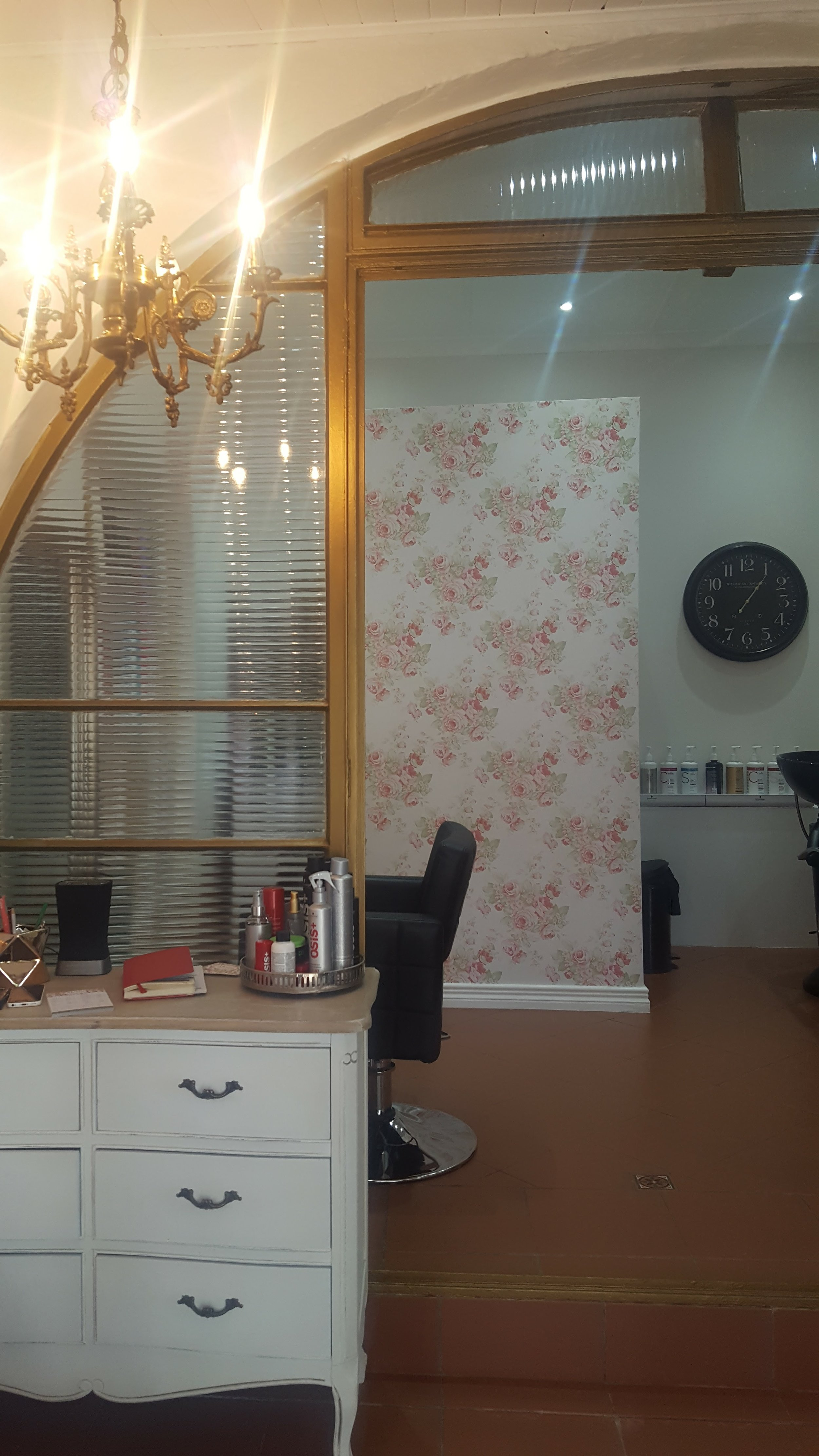 Gold trim with a floral hair salon colour consultation