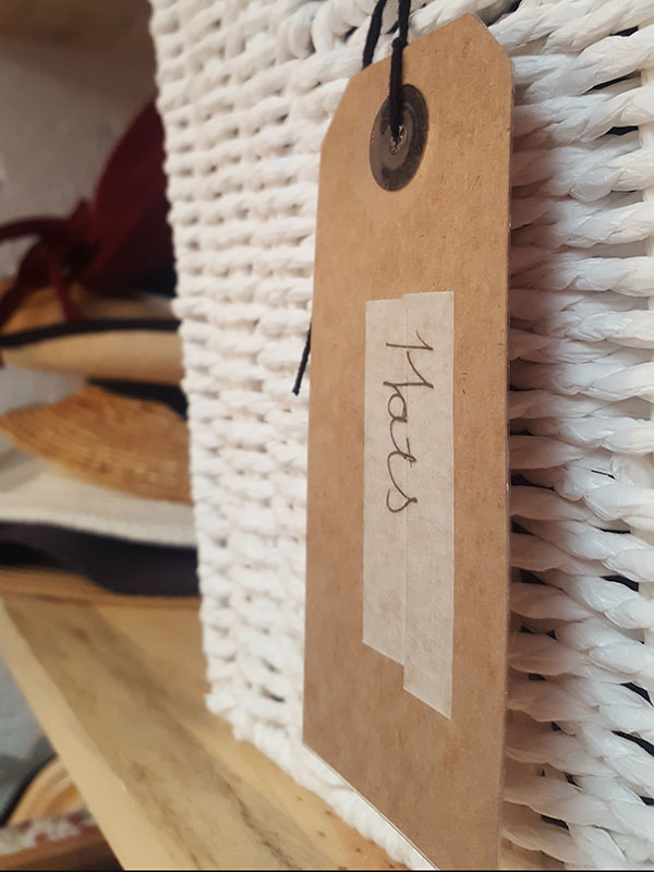 Label your baskets to make sense of neat and tidy uniformity and maximize space