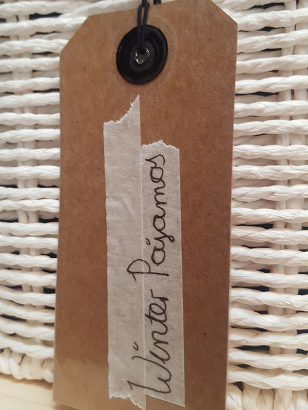Labels on baskets are an interior decorating tip to keep small spaces tidy.