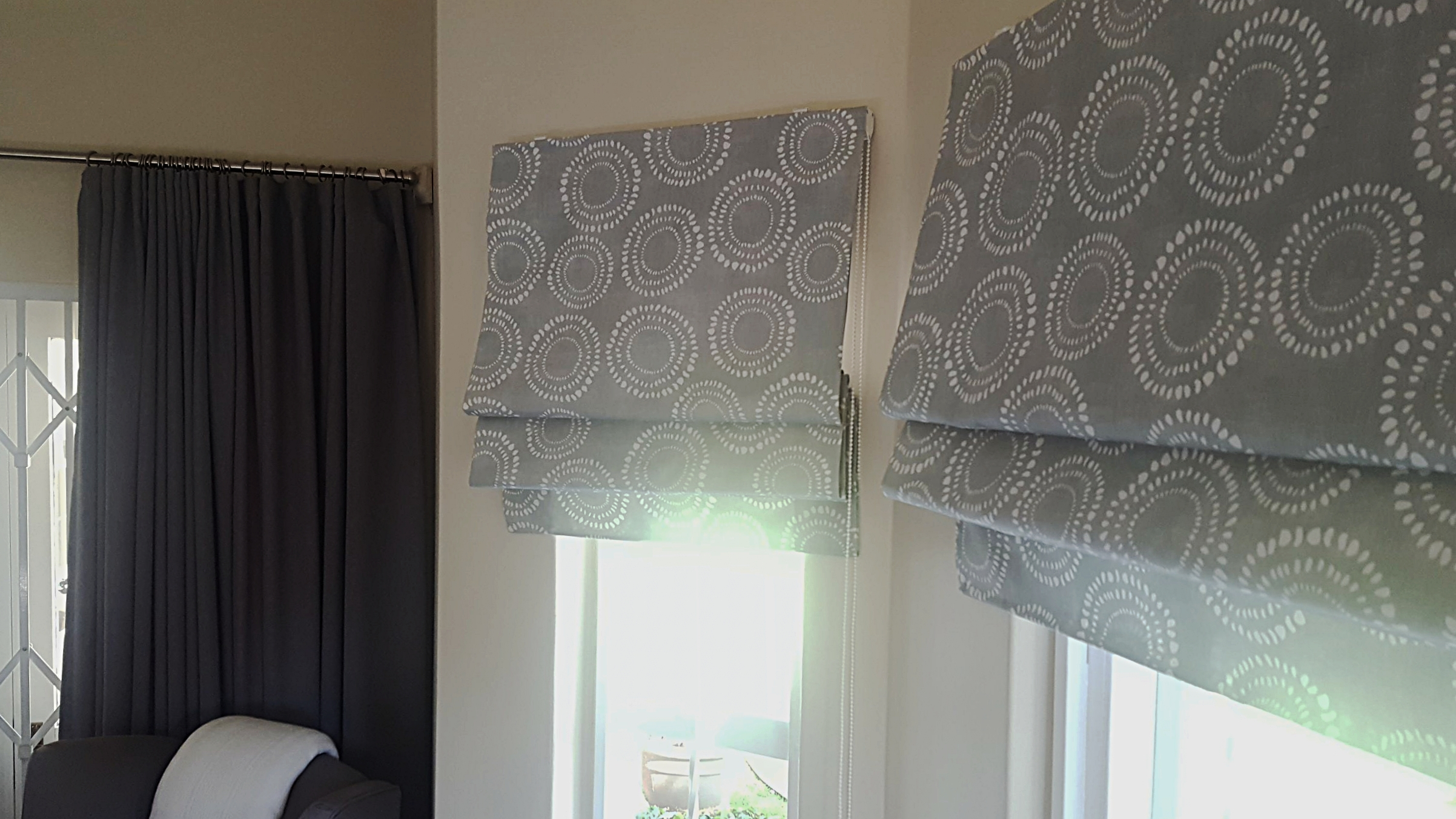 Beautiful duckegg Roman blinds to match white bedding and grey curtains in a country chic setting.