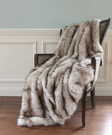 Faux Fur Throw Warms Up A Winter Home Using Texture