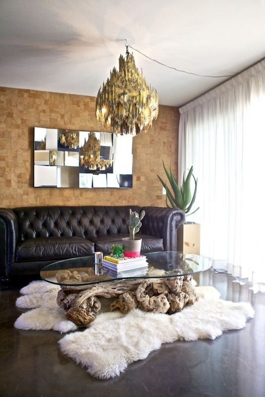 Designer home with shaggy fur rug, warm cladding and chandelier
