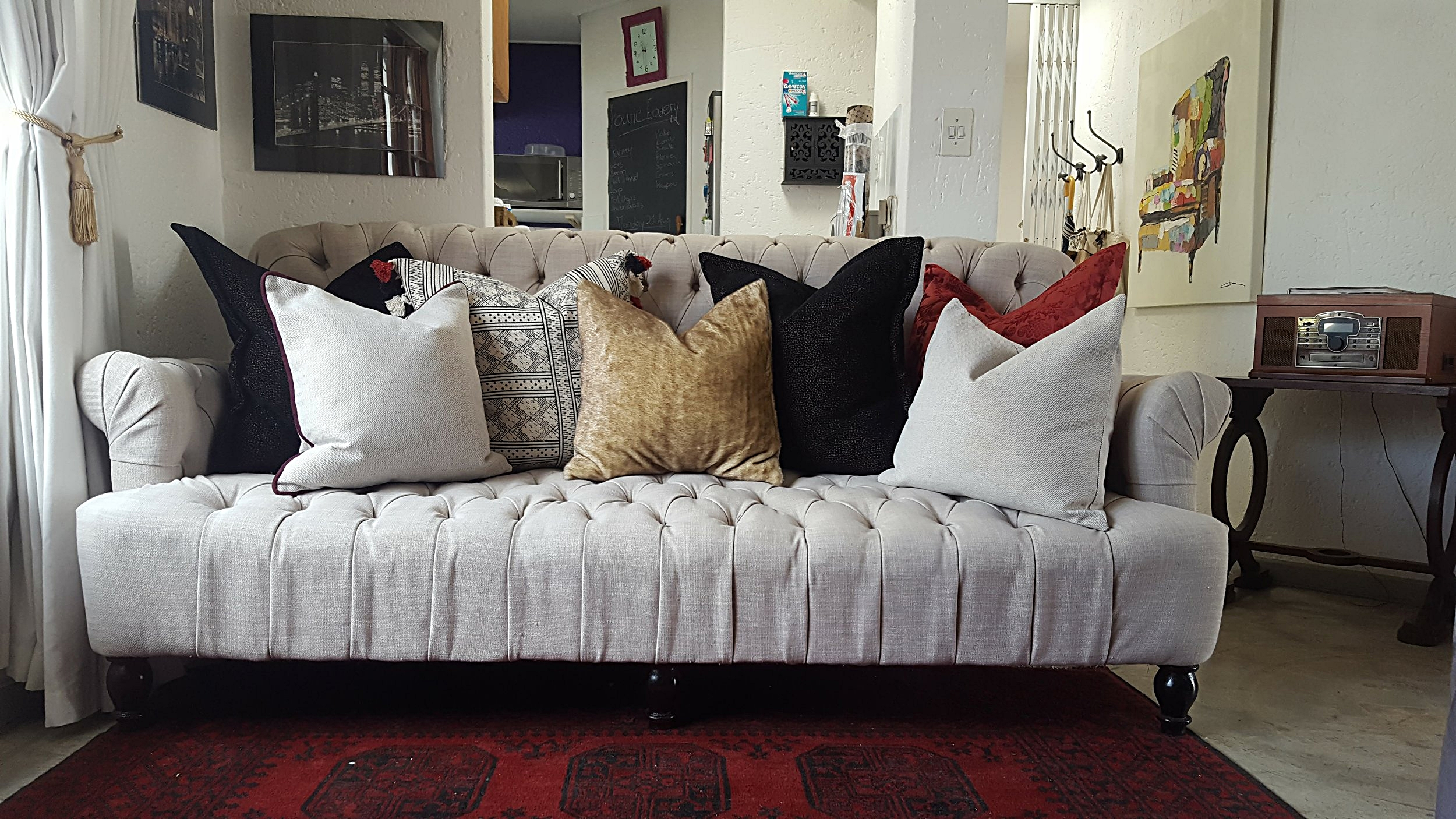 A feature couch with very a carefully designed scatter cushion collection by Tassels & Tigers Interior Designer and Decorator in Johannesburg, South Africa