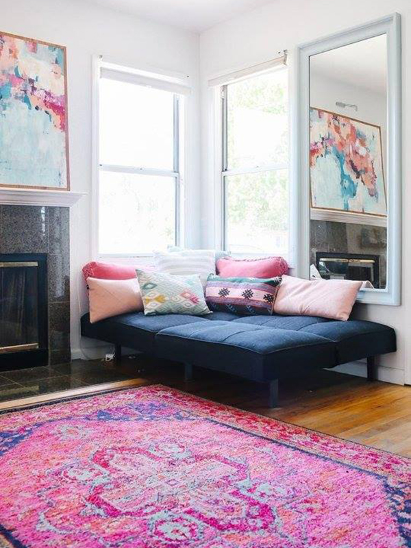 Tassels & Tigers Interior Design & Decor suggest a futon with colourful rug and scatters as guest room staple