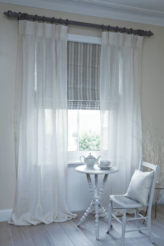 sheers over check curtains and roman blinds.jpg