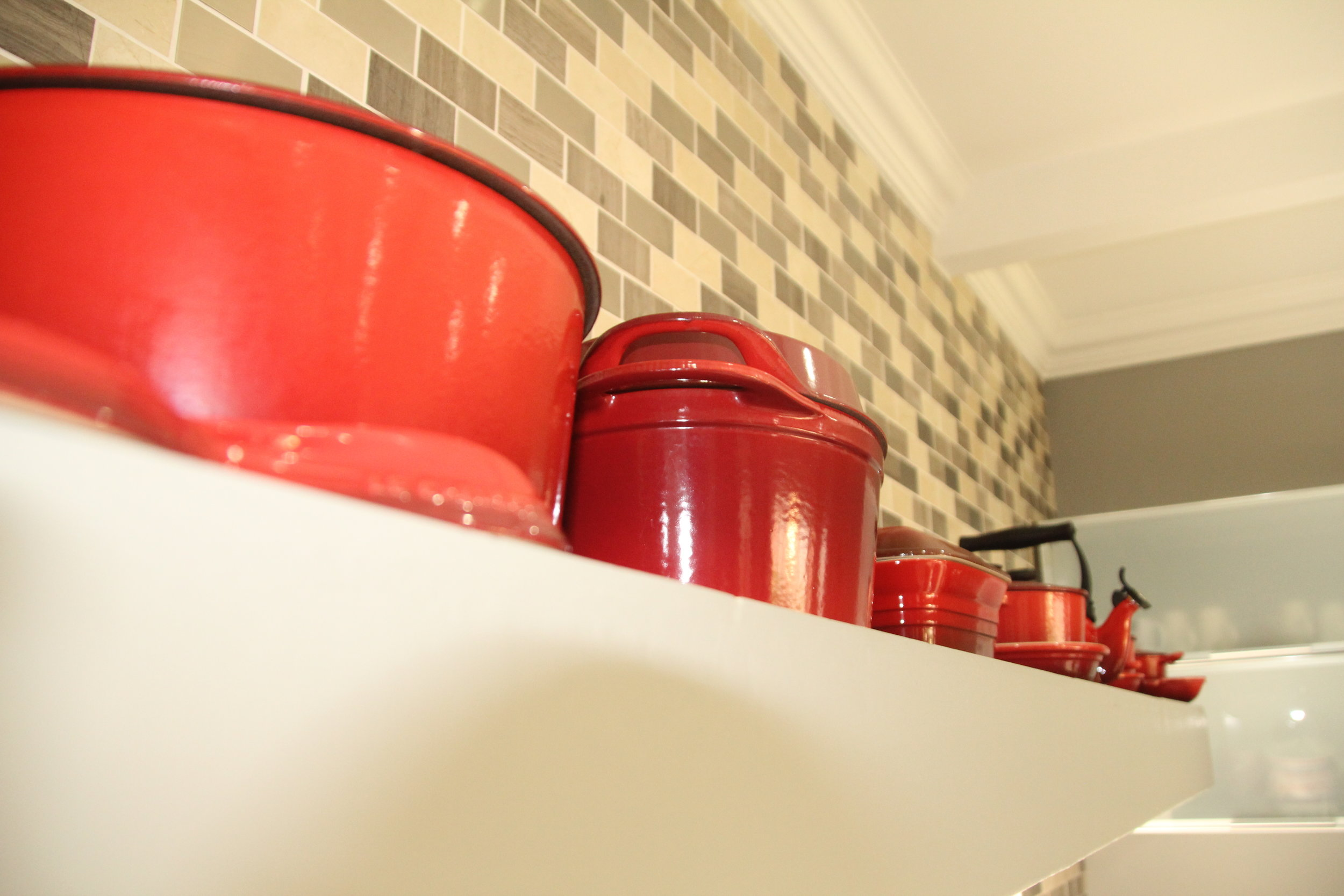 2 Le Creuset pots on display kitchen.JPG