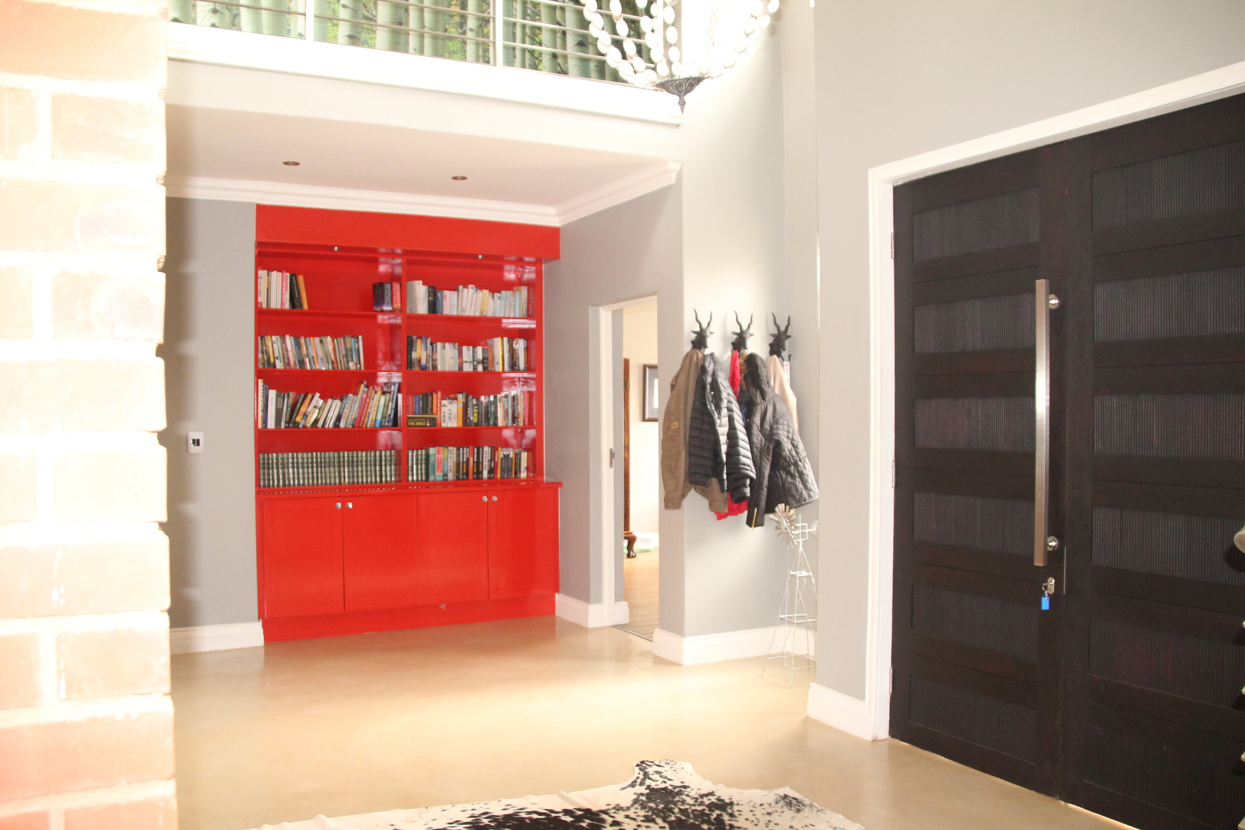 4 Entrance Hall with Red Bookshelf.JPG